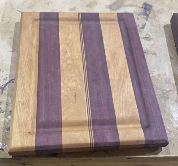 purpleheart cherry striped cutting board made in montana